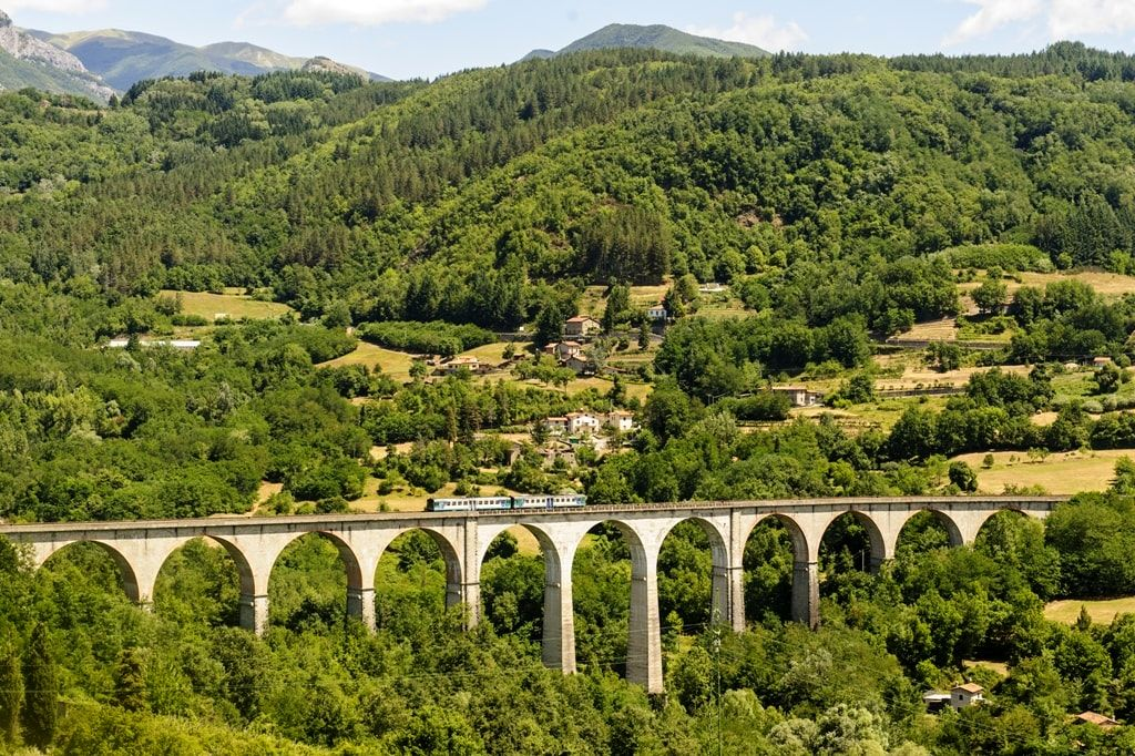 Landscape-in-Garfagnana-Lucca-Tuscany-Italy-at-summer-with-train-min