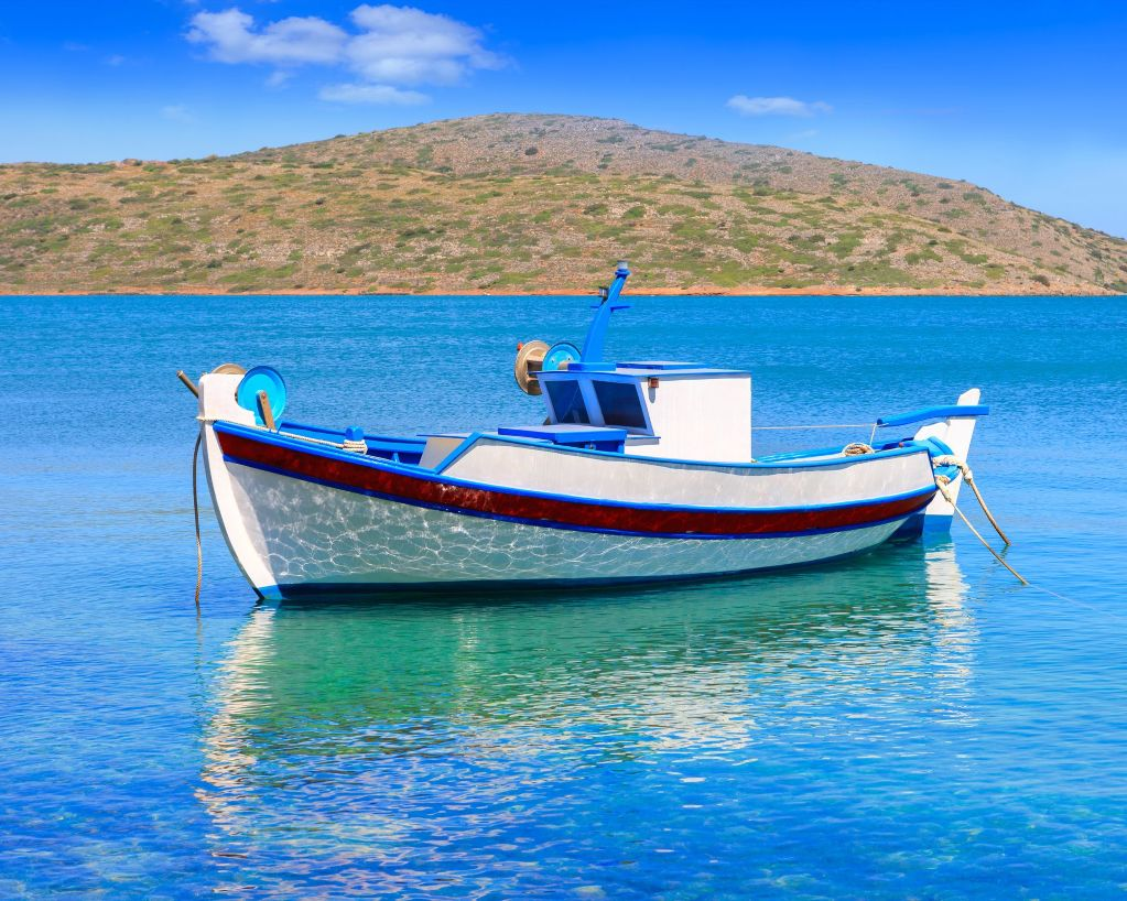 bigstock-Fishing-Boat-Off-The-Coast-Of--88047995_result